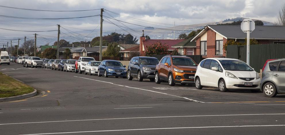 Cars queued for 500m from Shortland St and into Pages Rd, Aranui, to the Whānau Ora testing...