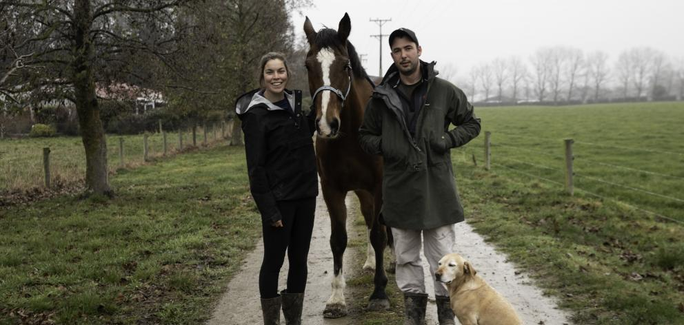 Dairy farm manager Carol Booth, pictured with partner Gordon Preedy, horse Legacy and Weasel the...