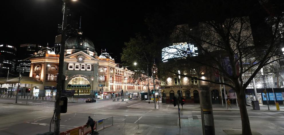 Central Melbourne is deserted after Victorian Premier Daniel Andrews announced a curfew earlier...