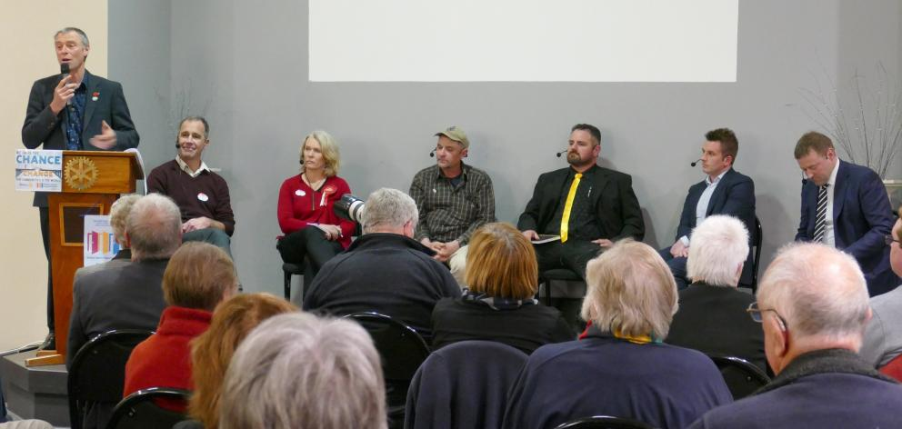 Chairman Stephen Woodhead (left) introduces election hopefuls for Taieri during the meet the...