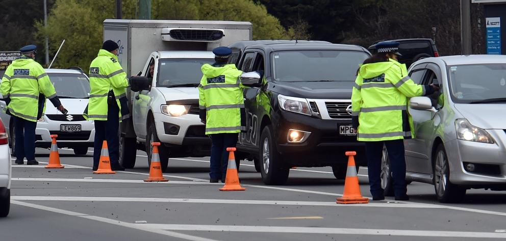 Police were busy breath-testing motorists in Kaikorai Valley Rd last night. PHOTO: PETER MCINTOSH