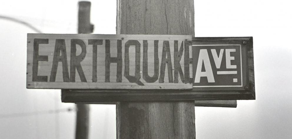 An altered street sign from about the time of the earthquake. PHOTOS: ODT FILES