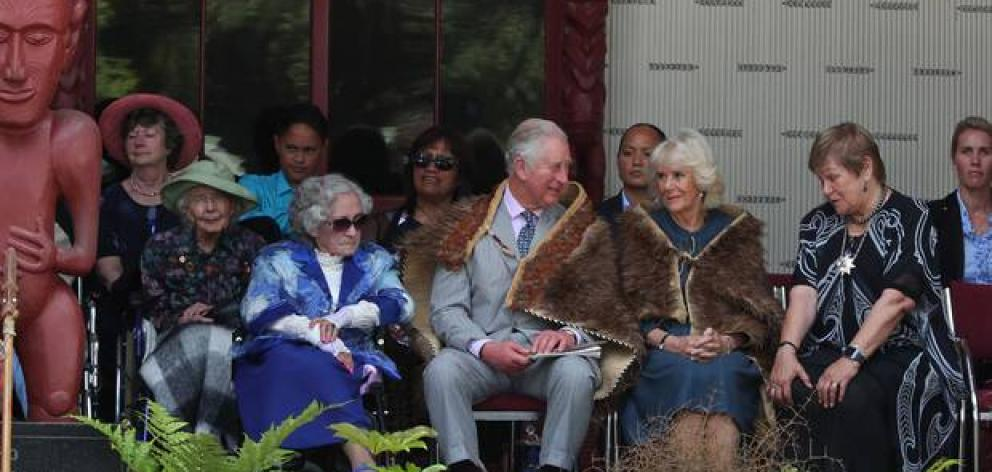Guest of honour Lady Ellen Elizabeth Reed (in the green hat) sat behind the royal couple when Prince Charles and Lady Camilla were welcomed to Waitangi last year. Photo: John Stone