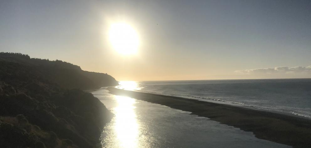 The setting sun looking north from the Hurunui River mouth.