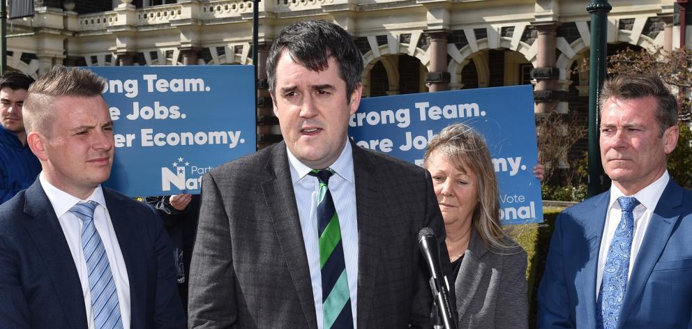 National Party transport spokesman Chris Bishop (centre) announces the party's ...