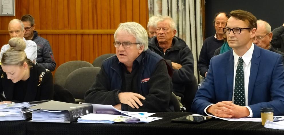 Coastguard Wanaka Lakes president Jonathan Walmisley (centre), flanked by counsel for the...