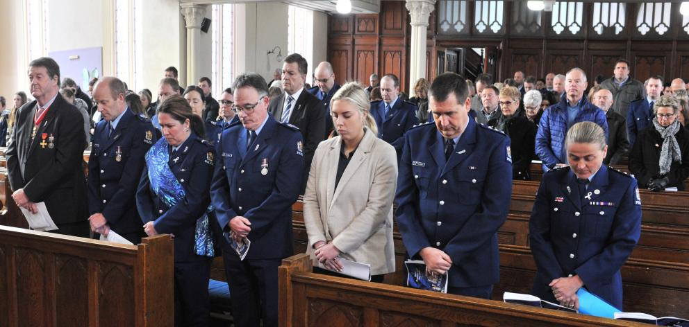A moment of silence is observed during yesterday's service at First Church.