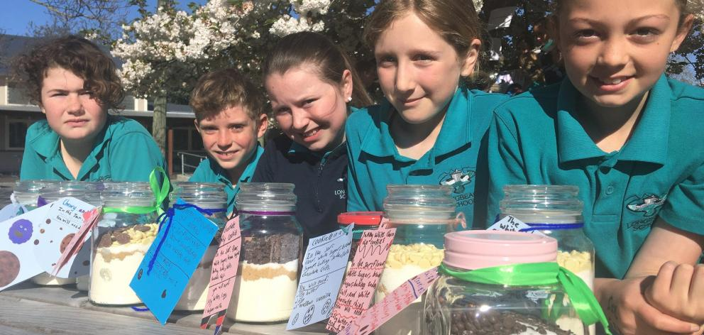 Margaret Russell, Ashton Lamont, Holly Burrowes, Abby Munroe and Sophie King with biscuit jars...
