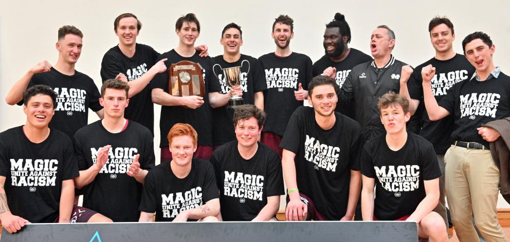 The champion Mid City Magic A team celebrates after winning its fourth consecutive men's club...