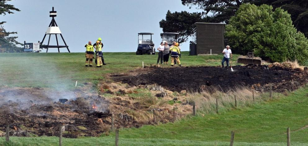 Firefighters at the St Clair Golf Course, in Hillhead Rd, yesterday.
