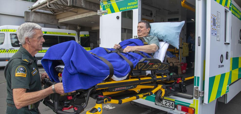 St John first responder Rob Rae helps Barry Smith into one of three big new ambulances, designed...