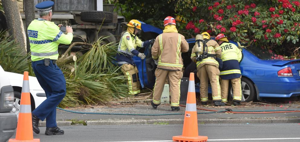 Emegency services attend an accident in Kaikorai Valley Rd near KFC on Thursday afternoon. PHOTO: Gregor Richardson