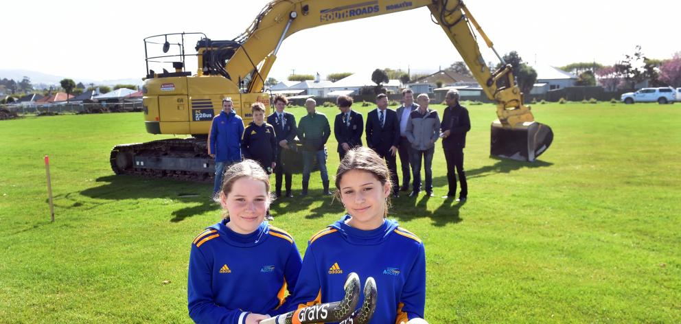 Sisters Sophie (13, left) and Chloe (15) Deerness, along with (from left) Otago Hockey...
