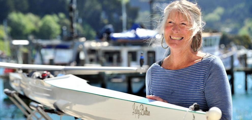 Lesley Bolton smiles while holding the boat named after her at the Port Chalmers United Rowing...