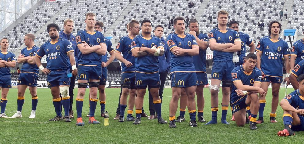 The Otago team watches as Hawke's Bay celebrates winning the Ranfurly Shield. PHOTO: PETER MCINTOSH