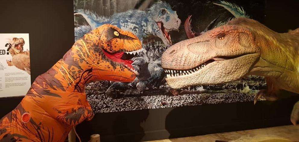 Rexie the T-Rex (Alfie Richardson, left) meets his ancestor at the Dinosaur rEvolution exhibition...