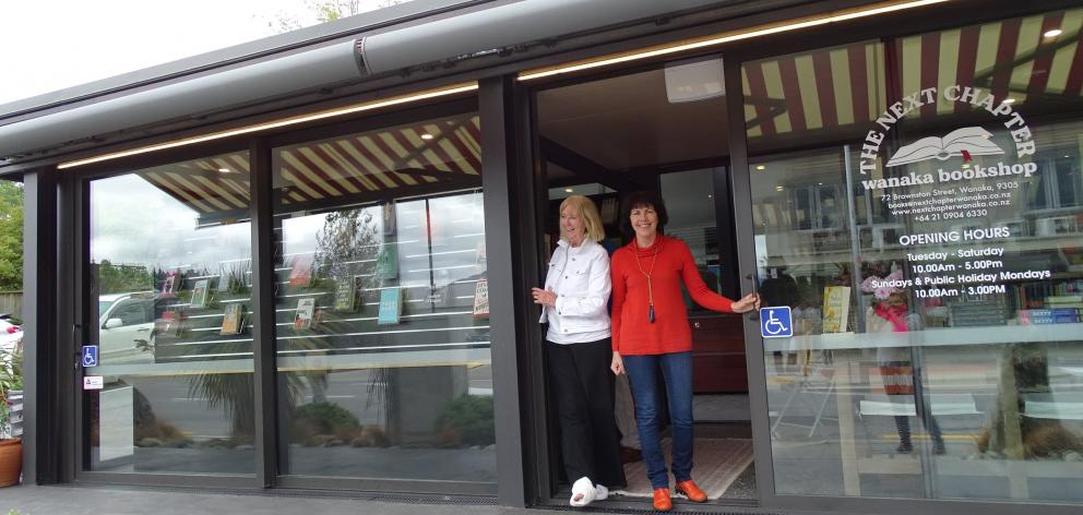 Managing to stand in the entrance to Wanaka's just opened independent book shop ''The Next...