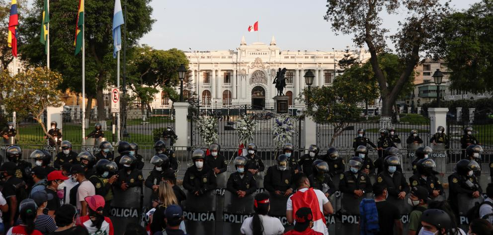 Police stand guard outside Congress after Peru's interim President Manuel Merino announced his resignation, in Lima. Photo: Reuters