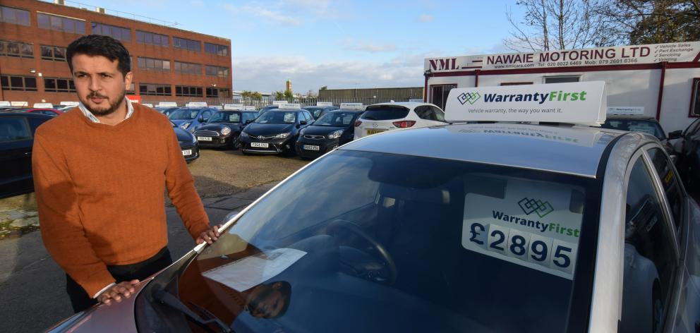 In Britain, Ameen Sultani says older, cheaper vehicles have been popular with customers eager to...