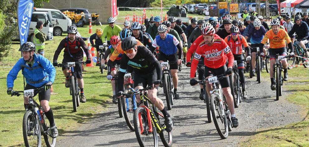 Cyclists get under way in the Coastal Classic mountain bike event at Livingstonia Park in Taieri...