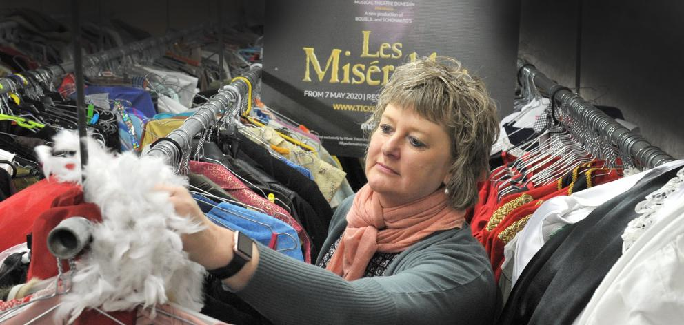 Musical Theatre Dunedin wardrobe manager June Driver dusts off costumes for the theatre company's...