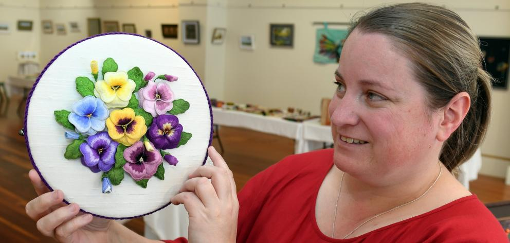 Pam Wilson, one of the organisers of the Otago Embroiderers' Guild two-yearly exhibition, holds...