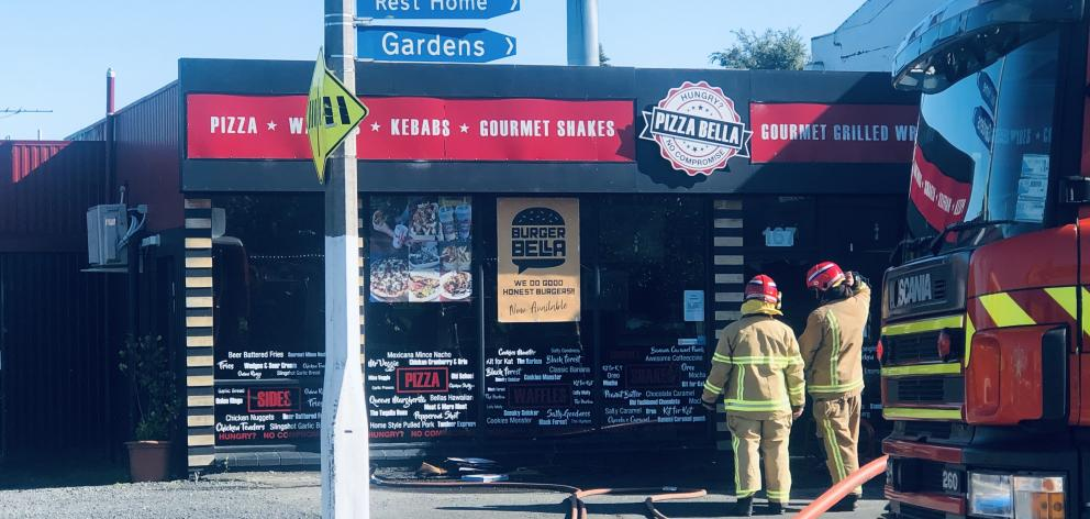 Fire crews were called to Pizza Bella in Mosgiel after a fire broke out in the kitchen. Photo: Craig Baxter