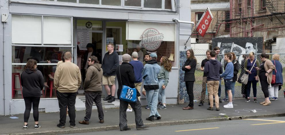 Customers queue for lunch on the last day of  Johnnie's Southern Kitchen in Rattray St. PHOTO:...