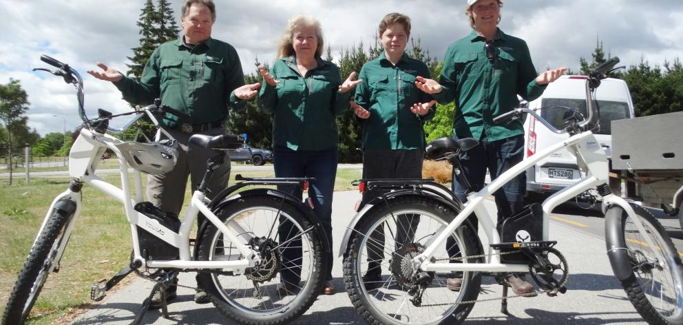 At the Lake Wanaka lakefront with two of their 80 e-bikes are (from left) Rik, Juliet, Bayne (14)...