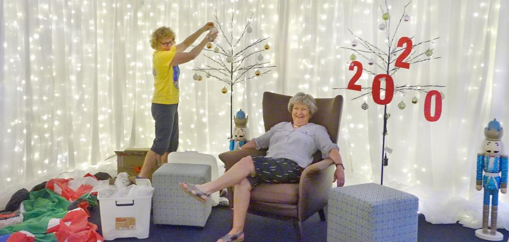 Ali Jarvis (left) and Yeverley McCarthy prepare Santa's Grotto for his arrival at the Wanaka...