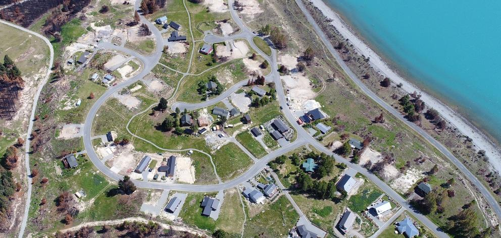 Cleared building sites show where houses were destroyed in the Lake Ohau village fire.