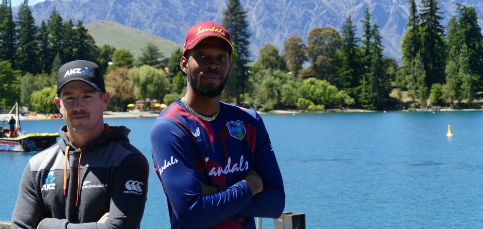 New Zealand A captain Cole McConchie (left) and his West Indies counterpart, Roston Chase, enjoy...