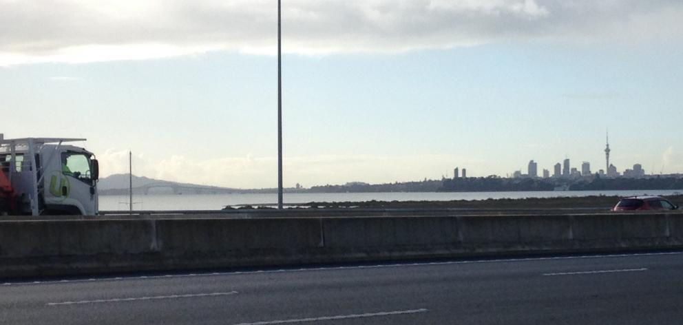 Rangitoto and the Auckland CBD from the North-Western Motorway. PHOTOS: ELEANOR HUGHES