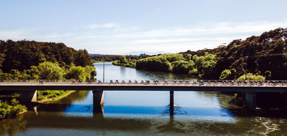 Riders pass over the Waiau River bridge at Clifton on stage two of the Tour of Southland...