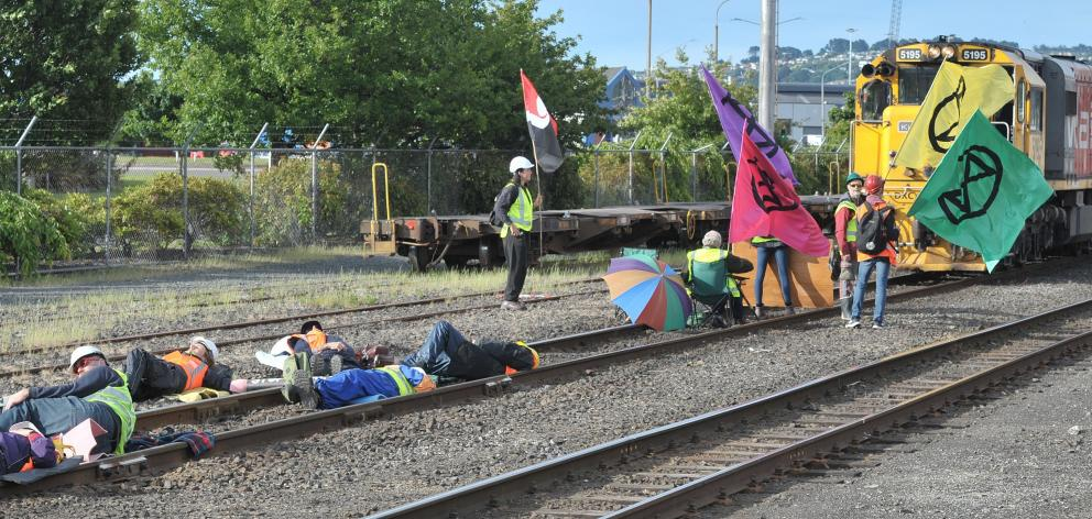 Climate change protesters, some locked to tracks, prevent a northbound coal train from moving...