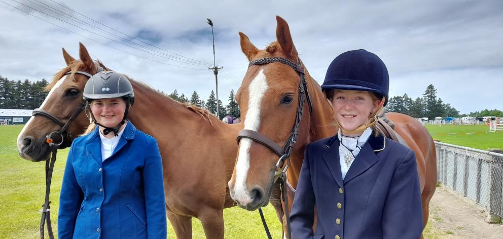 Hannah Thickett (from left) and Sophie Sauer, with horses Luna Eclipse and Griffindor Robinson...