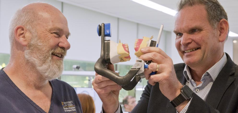 Dental School production laboratory technical services manager Steve Swindells (left) and oral...