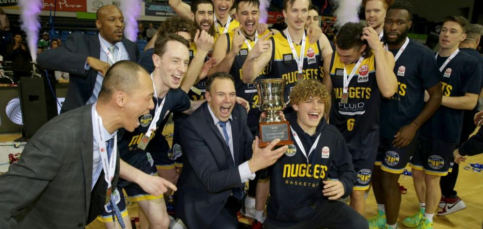 The Otago Nuggets celebrate after claiming their first NBL championship last night in Auckland....