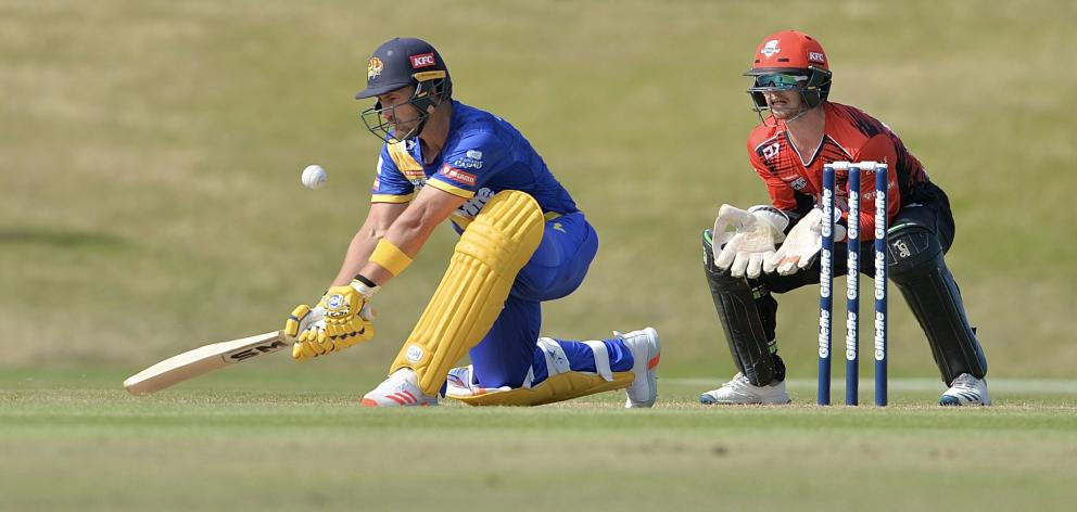 Neil Broom plays a reverse lap to score four runs as he opens in Otago's clash against Canterbury...