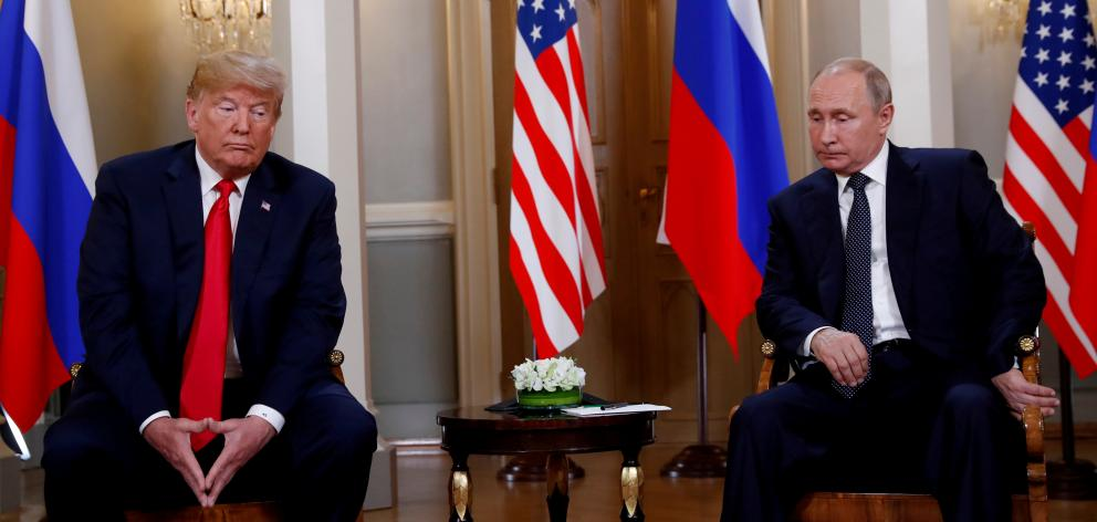 Donald Trump meeting with Russian President Vladimir Putin in Finland in 2018. Photo: Reuters