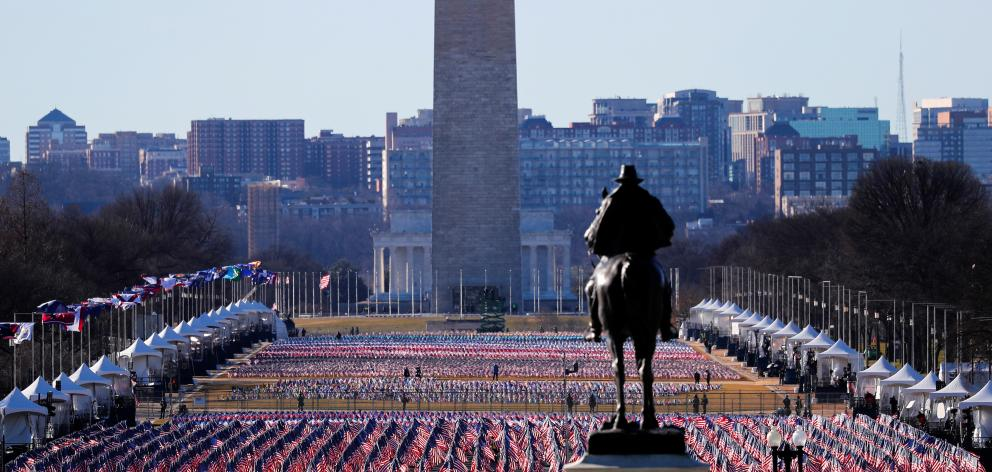 Thousands of US flags at the National Mall representing people unable to travel to Washington for...