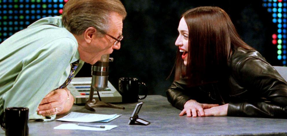 Singer and actress Madonna shares a laugh with Larry King in 1999. Photo: Reuters