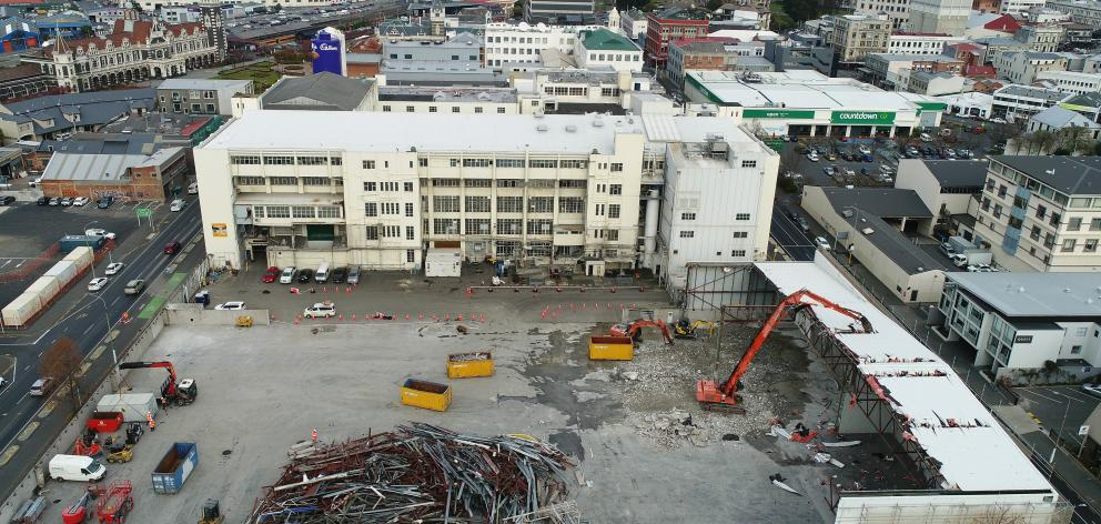 A high-reach digger removes roofing from the former Cadburys warehouse last month in preparation...