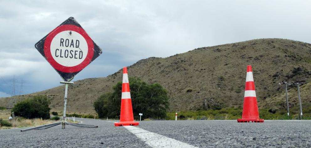 Access to the bridge was closed last week after heavy flooding washed part of it away. PHOTO:...