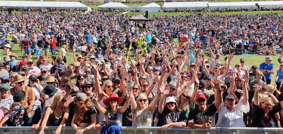 Fans begin to gather at the front of the stage for the final act of the day, Gin Wigmore, at the...