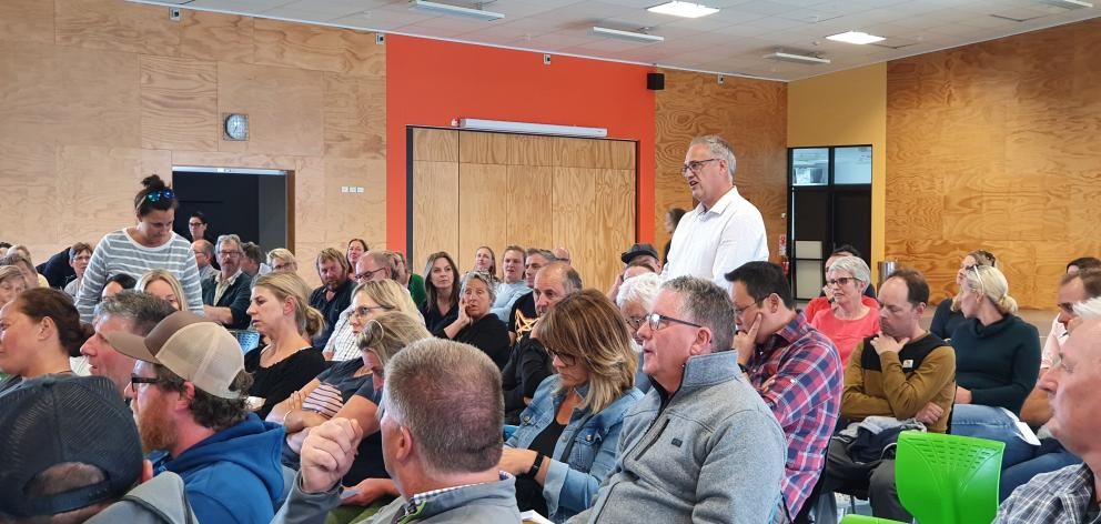 Lakes Hayes Estate resident Justin Ralston, at Shotover Primary School, questions if the proposed...
