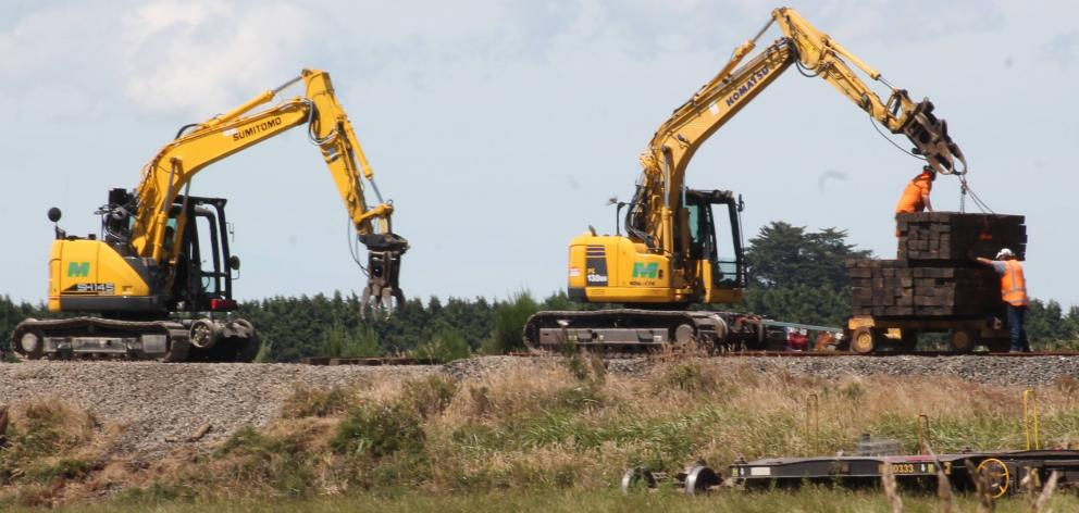 KiwiRail's contractors work to repair the damaged track at Wright's Bush after a train derailed....