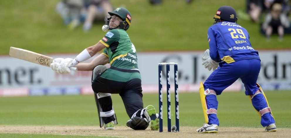 Stags batsman Will Young takes the ball during on the chin against the Volts at the University of...
