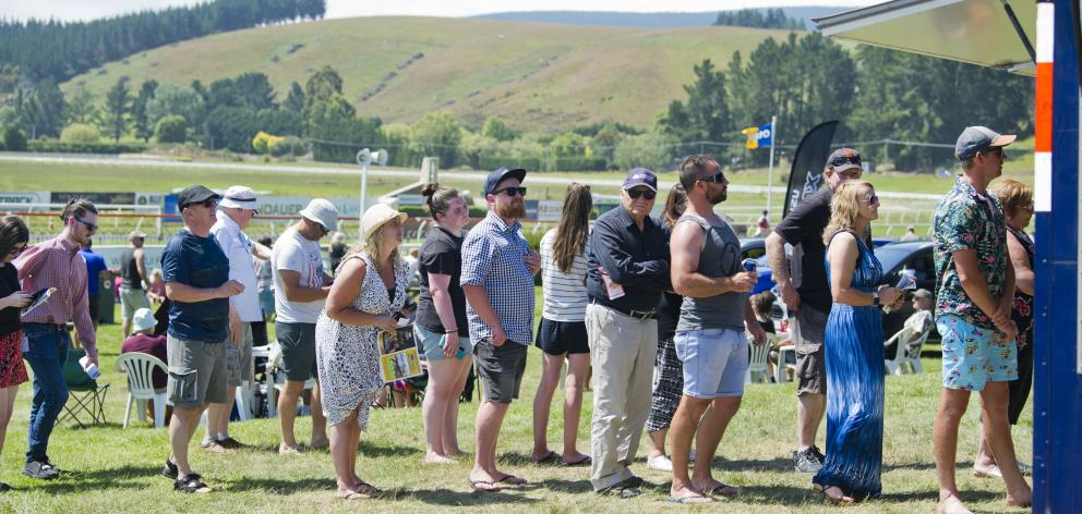 Punters were keen to get some liquid refreshments at Wingatui.