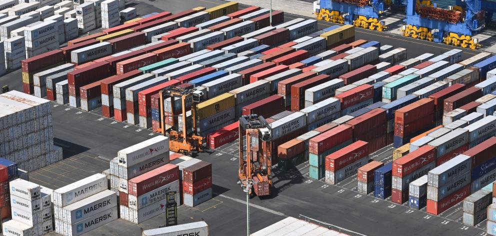 Shipping containers are stacked up at the Port Otago terminal, at Port Chalmers, yesterday. PHOTO...